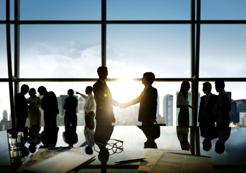 Group of business people and men handshake reflected onto table